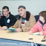 Three people speaking at the self-advocacy meeting in Israel