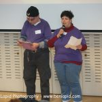 Two people speaking at the self-advocacy meeting in Israel